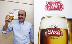 Carlos Brito, chief executive of Anheuser-Busch InBev poses with a Stella Artois beer after the annual shareholders meeting in Brussels, Belgium, April 27, 2016. REUTERS/Francois Lenoir