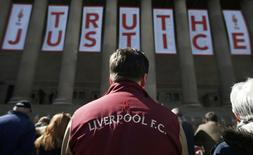 People look at floral tributes in memory of the victims of the Hillsborough disaster at St Georges Hall in Liverpool, northern England April 27, 2016. REUTERS/Phil Noble