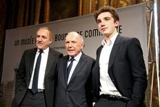 French businessman Francois Pinault (C) poses with his son Francois-Henri Pinault (L), CEO and Chairman of the board of directors of Kering, and his grandson Francois Pinault (R) after a news conference to announce plans for Paris art museum, at the Town hall in Paris, France, April 27, 2016.   REUTERS/Charles Platiau