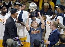 May 26, 2015; Cleveland, OH, USA; Cleveland Cavaliers owner Dan Gilbert celebrates with the Eastern Conference trophy after beating the Atlanta Hawks in game four of the Eastern Conference Finals of the NBA Playoffs at Quicken Loans Arena. Mandatory Credit: David Richard-USA TODAY Sports