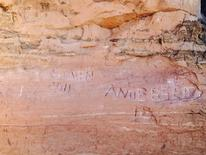 Graffiti is seen scratched into a sandstone wall near Frame Arch in Arches National Park near Moab, Utah, in this undated picture released by the National Park Service. Graffiti etched into one of the popular red rock arches in Utah's Arches National Park may be too deep to be repaired, the park's superintendent said on April 28, 2016.     REUTERS/National Park Service/Handout via Reuters