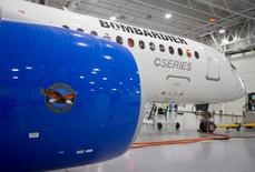 Bombardier's CS300 Aircraft, showing its Pratt & Whitney engine in the foreground, sits in the hangar prior to its test flight in Mirabel February 27, 2015. REUTERS/Christinne Muschi/File Photo