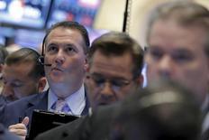 Traders work on the floor of the New York Stock Exchange (NYSE) in lower Manhattan in, New York, U.S., April 20, 2016. REUTERS/Brendan McDermid