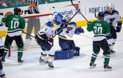 May 1, 2016; Dallas, TX, USA; Dallas Stars left wing Patrick Sharp (10) and center Cody Eakin (20) and St. Louis Blues defenseman Carl Gunnarsson (4) and goalie Brian Elliott (1) and defenseman Kevin Shattenkirk (22) look for the puck in midair during the overtime period in game two of the first round of the 2016 Stanley Cup Playoffs at the American Airlines Center. Jerome Miron-USA TODAY Sports