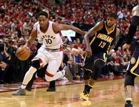 Toronto Raptors guard DeMar DeRozan (10) dribbles away from Indiana Pacers forward Paul George (13) in game seven of the first round of the 2016 NBA Playoffs at Air Canada Centre. Mandatory Credit: Dan Hamilton-USA TODAY Sports