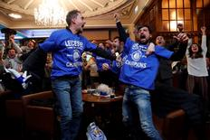 Britain Football Soccer - Leicester City fans watch the Chelsea v Tottenham Hotspur game in pub in Leicester - 2/5/16. Leicester City fans celebrate Chelsea's second goal. Reuters / Eddie Keogh