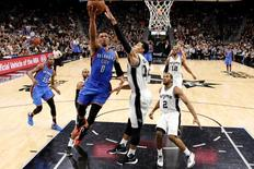 Oklahoma City Thunder point guard Russell Westbrook (0) shoots the ball as San Antonio Spurs shooting guard Danny Green (14) defends in game two of the second round of the NBA Playoffs at AT&T Center. Mandatory Credit: Soobum Im-USA TODAY Sports
