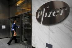 A man enters the employee entrance of the Pfizer World Headquarters building in the Manhattan borough of New York, U.S., November 23, 2015.  REUTERS/Brendan McDermid/Files