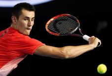 Australia's Bernard Tomic hits a shot during his third round match against compatriot John Millman at the Australian Open tennis tournament at Melbourne Park, Australia, January 24, 2016. REUTERS/Brandon Malone