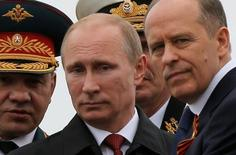 Russian President Vladimir Putin (C), Defence Minister Sergei Shoigu (L) and Russia's Federal Security Service (FSB) Director Alexander Bortnikov watch events to mark Victory Day in Sevastopol May 9, 2014.  REUTERS/Maxim Shemetov/File Photo - RTX2CSUW