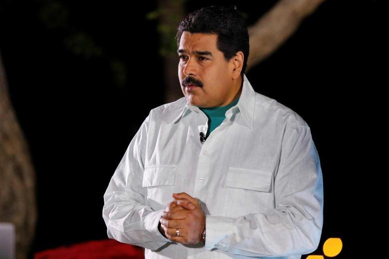 Venezuela's President Nicolas Maduro speaks during his weekly broadcast ''en contacto con Maduro'' (In contact with Maduro), in Margarita Island, Venezuela May 3, 2016. Miraflores Palace/Handout via REUTERS.