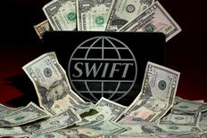 The SWIFT logo is pictured in this photo illustration taken April 26, 2016. REUTERS/Carlo Allegri/File Photo