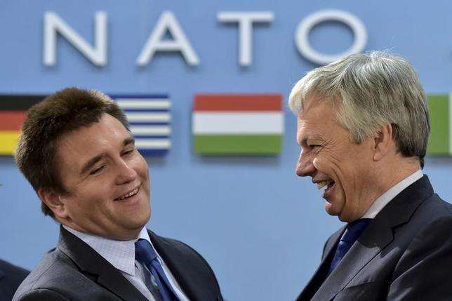 Ukraine's Foreign Minister Pavlo Klimkin (L) talks with Belgium's Foreign Minister Didier Reynders during a NATO foreign ministers meeting at the Alliance's headquarters in Brussels, Belgium, December 2, 2015. REUTERS/Eric Vidal