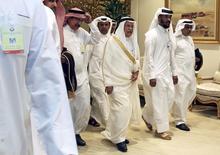 Министр нефти Саудовской Аравии Али аль-Наими прибывает на встречу стран-производителей нефти в Дохе. Немногие из собравшихся на встрече ОПЕК на этой неделе для разработки долгосрочной стратегии ожидали, что обсуждения закончатся мирно. Однако даже самые искушенные делегаты получили больше, чем рассчитывали. REUTERS/Ibraheem Al Omari/File Photo