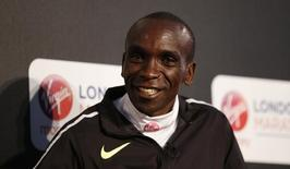 Athletics - 2016 Virgin Money London Marathon Winners Photocall - The Tower Hotel, St Katharine's Way, London - 25/4/16 Winner of the elite men's race, Kenya's Eliud Kipchoge during the press conference  Action Images via Reuters / Peter Cziborra