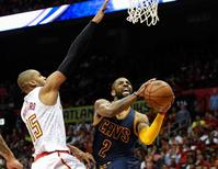 May 6, 2016; Atlanta, GA, USA; Cleveland Cavaliers guard Kyrie Irving (2) goes to the basket past Atlanta Hawks center Al Horford (15) during the second half in game three of the second round of the NBA Playoffs at Philips Arena. The Cavaliers defeated the Hawks 121-108. Mandatory Credit: Dale Zanine-USA TODAY Sports