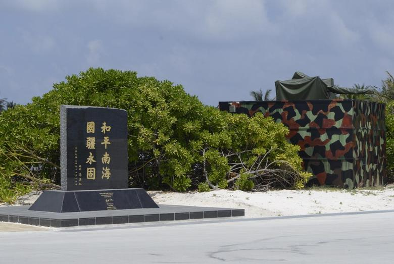 A memorial plaque signed by Taiwan President Ma Ying-jeou, which is engraved with the words, ''Peace in the South China Sea and our national territory secure forever'', is seen in Itu Aba, which the Taiwanese call Taiping, South China Sea,Taiwan March 23, 2016. REUTERS/Fabian Hamacher/File Photo