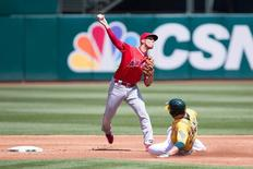 Apr 13, 2016; Oakland, CA, USA; Oakland Athletics third baseman Danny Valencia (26) is forced out at second as Los Angeles Angels shortstop Andrelton Simmons (2) tries to turn a double play in the second inning at O.co Coliseum. Mandatory Credit: Neville E. Guard-USA TODAY Sports