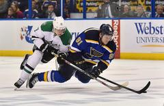 May 9, 2016; St. Louis, MO, USA; Dallas Stars center Mattias Janmark (13) and St. Louis Blues right wing Vladimir Tarasenko (91) tangle during the second period in game six of the second round of the 2016 Stanley Cup Playoffs at Scottrade Center. Mandatory Credit: Jasen Vinlove-USA TODAY Sports
