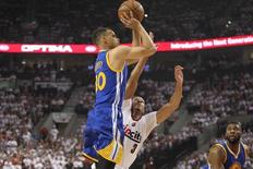 May 9, 2016; Portland, OR, USA; Golden State Warriors guard Stephen Curry (30) shoots over Portland Trail Blazers guard C.J. McCollum (3) in game four of the second round of the NBA Playoffs at Moda Center at the Rose Quarter. Mandatory Credit: Jaime Valdez-USA TODAY Sports