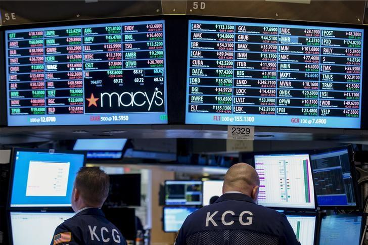 Specialist traders for KCG Holdings work at a post on the floor of the New York Stock Exchange April 9, 2015. REUTERS/Brendan McDermid