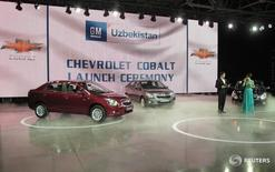 General Motors new Chevrolet Cobalt sedans are seen during the launch ceremony in Tashkent September 5, 2012. Ninety-four percent of new cars sold in Uzbekistan last year were made by General Motors - the biggest share of any market served by the U.S. auto giant. That General Motors should have a foothold in the reclusive former Soviet republic owes much to the technology and capital it brings to a country which, under veteran President Islam Karimov, has been the graveyard of many foreign ventures. To match story GM-UZBEKISTAN/  REUTERS/Shavkat Rakhmatullaev  (UZBEKISTAN - Tags: BUSINESS EMPLOYMENT TRANSPORT) - RTR37J59