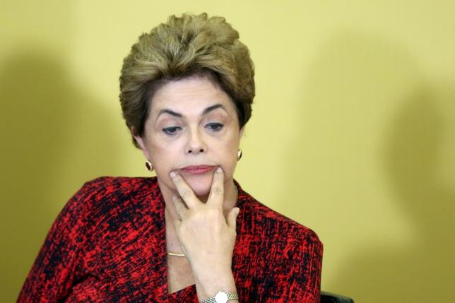 Brazil's President Dilma Rousseff reacts as she attends a signing ceremony for new universities, at Planalto Palace in Brasilia, Brazil, May 9, 2016. REUTERS/Adriano Machado - RTX2DJ5S