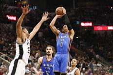 May 10, 2016; San Antonio, TX, USA; Oklahoma City Thunder point guard Russell Westbrook (0) shoots the ball over San Antonio Spurs power forward Tim Duncan (21) in game five of the second round of the NBA Playoffs at AT&T Center. Mandatory Credit: Soobum Im-USA TODAY Sports