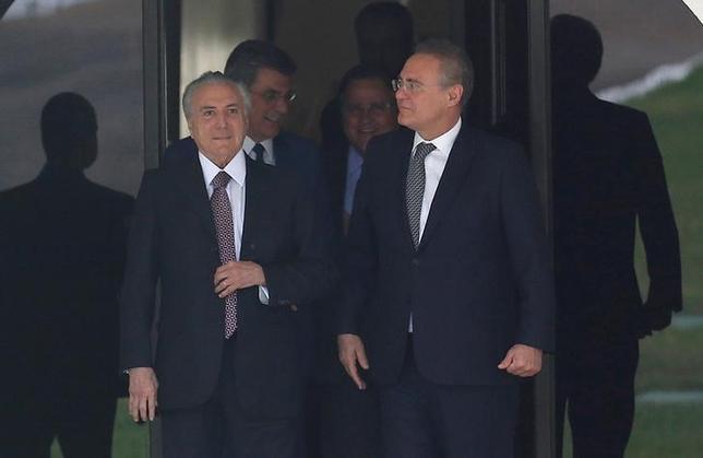 Brazil's Vice President Michel Temer (L) talks with President of the Brazilian Senate Renan Calheiros as he leaves the Calheiros' house in Brasilia, Brazil, May 10, 2016.  REUTERS/Paulo Whitaker