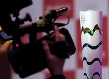 A cameraman shoots the Rio 2016 Olympic torch during a National Sports Forum seminar  in Sao Paulo, Brazil, September 9, 2015. REUTERS/Paulo Whitaker/File Photo