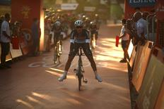 Etixx-Quick Step rider Gianluca Brambilla of Italy stretches his legs as he leads his team to the finish line during the 7.4 km (4.6 miles) team time trial in the first stage of the Vuelta Tour of Spain cycling race from Puerto Banus to Marbella, in Marbella, southern Spain, August 22, 2015. REUTERS/Jon Nazca