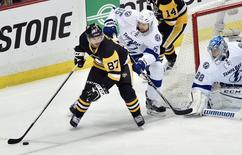 May 16, 2016; Pittsburgh, PA, USA; Pittsburgh Penguins center Sidney Crosby (87) looks to center the puck against Tampa Bay Lightning defenseman Braydon Coburn (55) and goalie Andrei Vasilevskiy (88) during the third period in game two of the Eastern Conference Final of the 2016 Stanley Cup Playoffs at Consol Energy Center. Pittsburgh won 3-2 in OT.Mandatory Credit: Don Wright-USA TODAY Sports