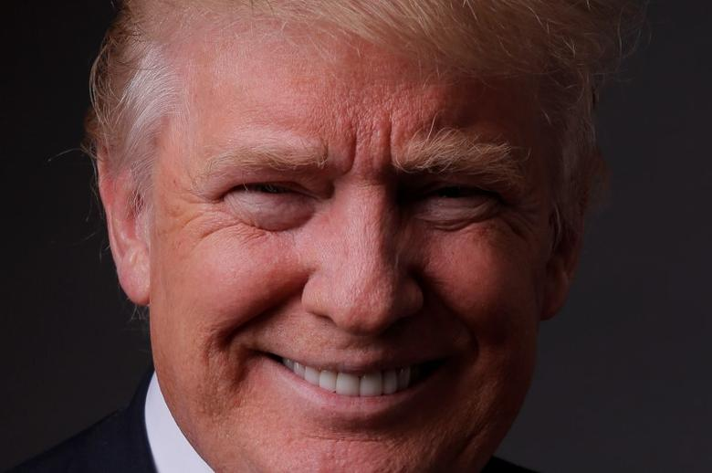 Republican U.S. presidential candidate Donald Trump poses for a photo after an interview with Reuters in his office in Trump Tower, in the Manhattan borough of New York City, May 17, 2016. REUTERS/Lucas Jackson