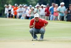 May 13, 2016; Ponte Vedra Beach, FL, USA; Jordan Spieth lines up a putt on the 7th green during the second round of the 2016 Players Championship golf tournament at TPC Sawgrass - Stadium Course. Mandatory Credit: Jason Getz-USA TODAY Sports