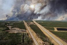 An aerial view of Highway 63 south of Fort McMurray, Alberta. Canada, shows smoke from the wildfires taken from a CH-146 Griffon helicopter May 5, 2016.  MCPL VanPutten/Canadian Armed Forces/Handout via Reuters