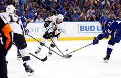 May 18, 2016; Tampa, FL, USA; Pittsburgh Penguins left wing Conor Sheary (43) shoots as Tampa Bay Lightning left wing Jonathan Drouin (27) and defenseman Andrej Sustr (62) defend during the second period of game three of the Eastern Conference Final of the 2016 Stanley Cup Playoffs at Amalie Arena. Mandatory Credit: Kim Klement-USA TODAY Sports
