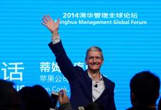 Apple CEO Tim Cook waves as he attends a talk in Beijing October 23, 2014. China Daily/via REUTERS/File Photo