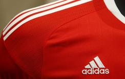 An Adidas logo is pictured at a shirt before the company annual general meeting in the northern Bavarian town of Fuerth near Nuremberg, Germany, May 12, 2016. REUTERS/Michaela Rehle