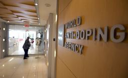 A woman walks into the head office for the World Anti-Doping Agency (WADA) in Montreal, Quebec, Canada on November 9, 2015.  REUTERS/Christinne Muschi/File Photo
