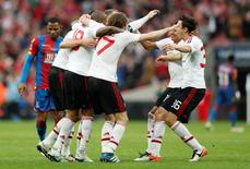 Britain Football Soccer - Crystal Palace v Manchester United - FA Cup Final - Wembley Stadium - 21/5/16 Manchester United players celebrate winning the final as Jason Puncheon looks dejected Action Images via Reuters / John Sibley