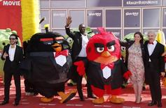 "(L-R) Actors Timur Rodriguez and Omar Sy, tv host Raya Abirached and actor Maccio Capatonda pose during a photocall for the animated film ""The Angry Birds Movie"" on the eve of the start of the 69th Cannes Film Festival in Cannes, France, May 10, 2016.  REUTERS/Jean-Paul Pelissier"