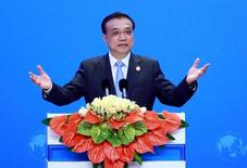 China's Premier Li Keqiang speaks at the opening ceremony of Boao Forum in Boao, Hainan Province, China, March 24, 2016. REUTERS/China Daily