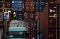 A laborer works in a container area at a port in Tokyo, Japan, March 16, 2016.    REUTERS/Toru Hanai/File Photo