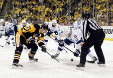May 22, 2016; Pittsburgh, PA, USA; Pittsburgh Penguins center Evgeni Malkin (71) and Tampa Bay Lightning center Brian Boyle (11) take a face-off during the third period in game five of the Eastern Conference Final of the 2016 Stanley Cup Playoffs at the CONSOL  Energy Center. Tampa Bay won 4-3 in overtime to take a three games to two lead in the series. Mandatory Credit: Charles LeClaire-USA TODAY Sports