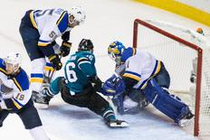 May 25, 2016; San Jose, CA, USA; San Jose Sharks center Nick Spaling (16) tries to score against St. Louis Blues goalie Brian Elliott (1) in the third period of game six in the Western Conference Final of the 2016 Stanley Cup Playoffs at SAP Center at San Jose. The Sharks won 5-2.  Mandatory Credit: John Hefti-USA TODAY Sports