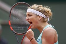 Tennis - French Open - Roland Garros - Eugenie Bouchard of Canada vs Timea Bacsinszky of Switzerland. - Paris, France - 26/05/16. Timea Bacsinsky reacts. REUTERS/Pascal Rossignol