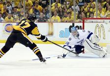 May 26, 2016; Pittsburgh, PA, USA; Tampa Bay Lightning goalie Andrei Vasilevskiy (88) makes a save against Pittsburgh Penguins right wing Bryan Rust (17) during the third period in game seven of the Eastern Conference Final of the 2016 Stanley Cup Playoffs at the CONSOL  Energy Center. The Penguins won the game 2-1 and the Eastern Conference Championship four games to three. Mandatory Credit: Charles LeClaire-USA TODAY Sports