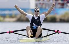 Mahe Drysdale of New Zealand celebrates winning gold in the men's rowing Single Sculls final during the London 2012 Olympic Games at Eton Dorney August 3, 2012.  REUTERS/Pool