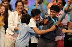 May 26, 2016; National Harbor, MD, USA; Jairam Hathwar, 13, of Painted Post, N.Y. (L), and Nihar Janga, 11, of Austin, Texas (R), celebrate as co-champions during the 2016 Scripps National Spelling Bee at the Gaylord National Resort and Convention Center. Mandatory Credit: Christopher Powers-USA TODAY NETWORK