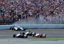 May 25, 2014; Indianapolis, IN, USA; IndyCar Series drivers Ed Carpenter and James Hinchcliffe crash in turn one during the 2014 Indianapolis 500 at Indianapolis Motor Speedway. Mandatory Credit: Justin Tooley-USA TODAY Sports